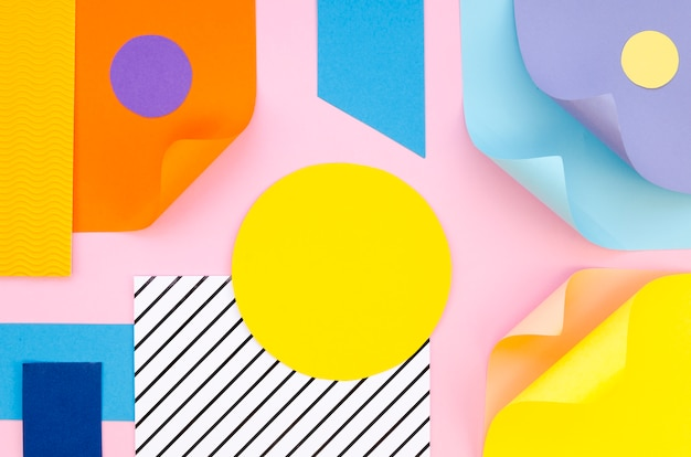 Top view of colorful paper geometry and shapes Free Photo