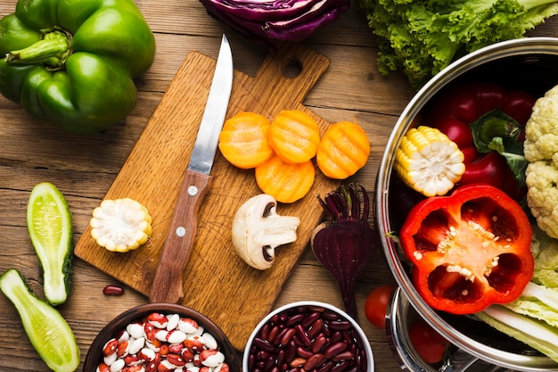 Top view colorful vegetables assortment on wooden background Free Photo