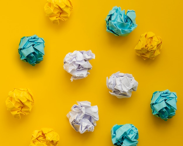 Top view colourful crumpled pieces of paper Free Photo
