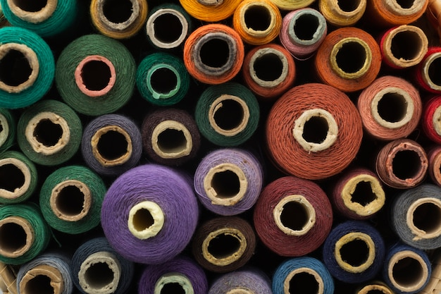 Top view colourful sewing threads background Free Photo