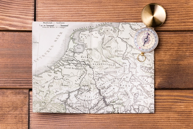Top view compass on top of world map Premium Photo