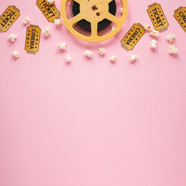 Top view composition of cinema elements on pink background with copy space Premium Photo
