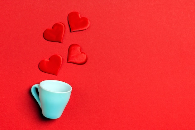 Top view composition of red hearts falling out from a cup Premium Photo