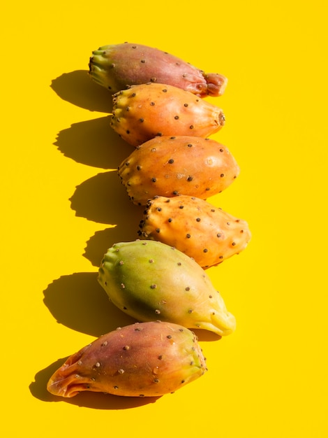 Top view composition with vegetables and yellow background Free Photo