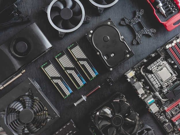Top view of computer parts with hard disk, ram, cpu, graphics card, and motherboard Premium Photo