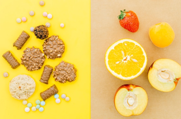 Top view cookies vs fruit Free Photo