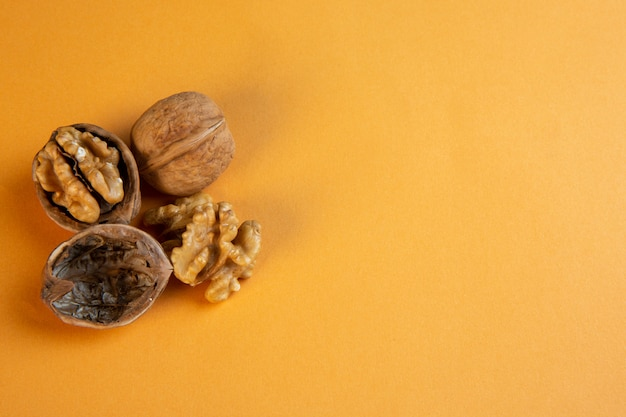 Top view copy space walnuts on mustard Free Photo