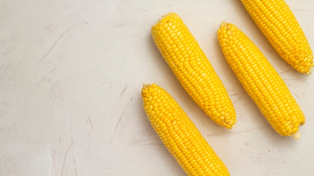 Top view corns with white background Free Photo