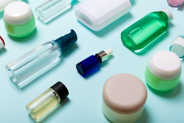 Top view of cosmetic products in different jars and bottles Premium Photo