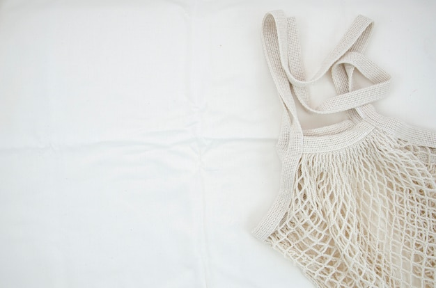 Top view cotton net bag on white background Free Photo
