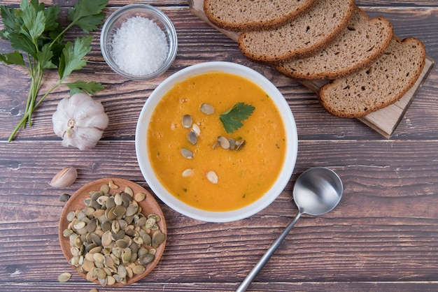 Top view cream soup with slices of bread Free Photo