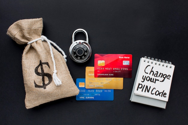 Top view of credit cards with lock and money bag Free Photo