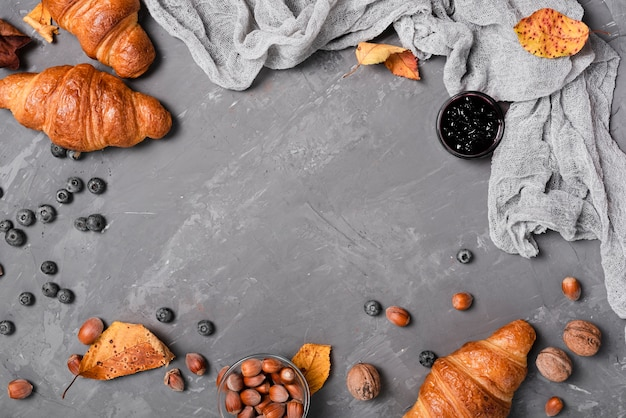 Top view of croissants, jam and chestnuts Free Photo