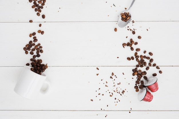 [Image: top-view-cup-coffee-with-grains-capsules...173477.jpg]