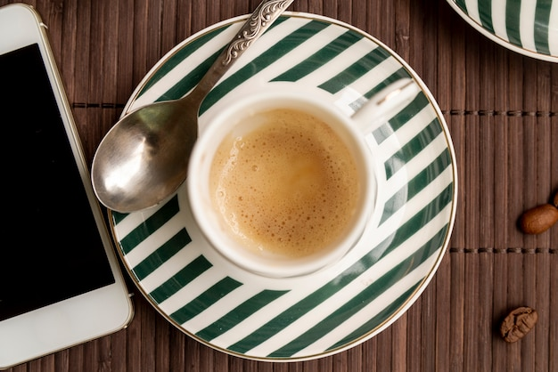 Top view cup of coffee with a smartphone Free Photo