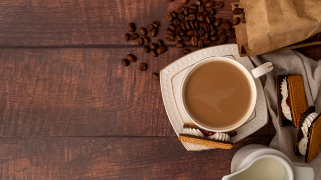 Top view cup of coffee with sweets Free Photo
