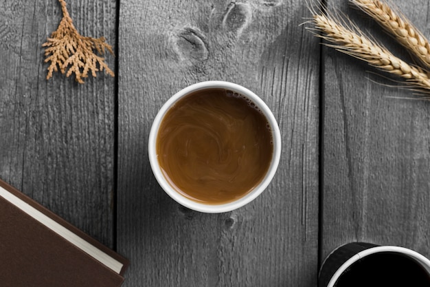 Top view cup of coffee on wooden background Free Photo