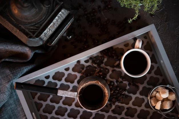 Вид сверху чашка кофе с кусочками сахара Бесплатные Фотографии