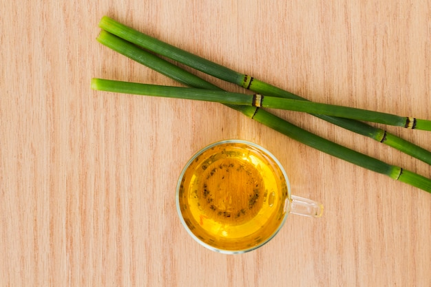 Top view cup of tea with bamboos Free Photo