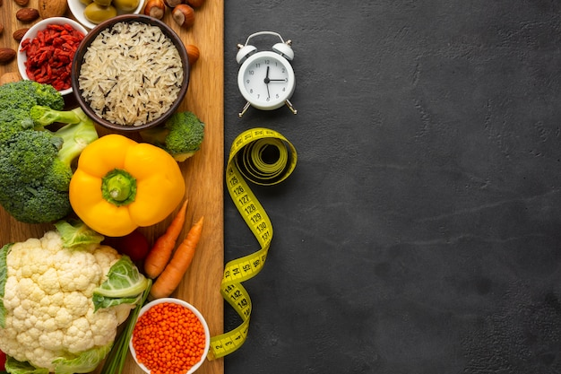 Top view of cutting board with groceries Free Photo