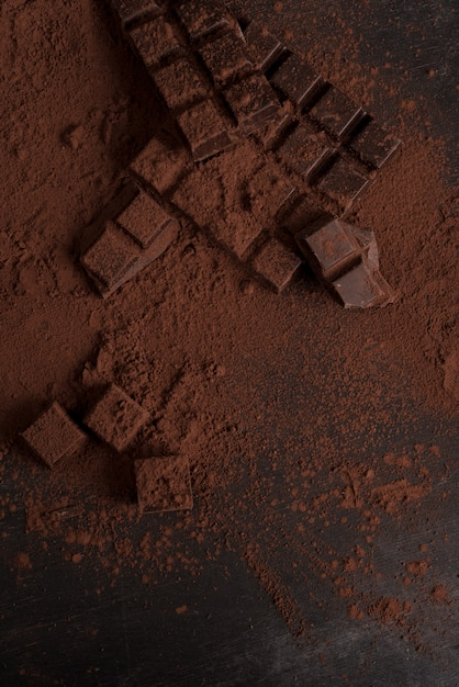 Top view of dark chocolate blocks crashed into pieces Free Photo