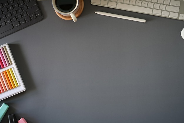 Top view dark grey workspace with office gadget and copy space Premium Photo