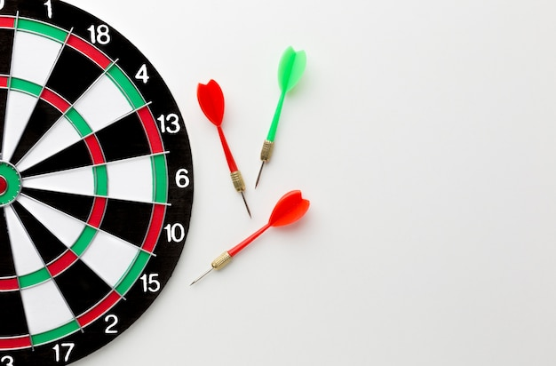 Top view of darts with copy space and target Free Photo