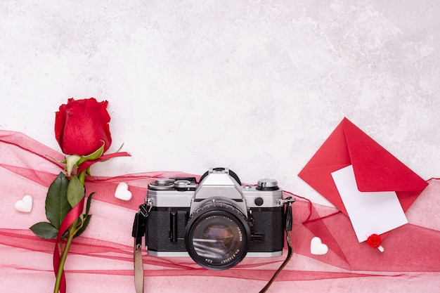 Top view decoration with camera and rose Free Photo
