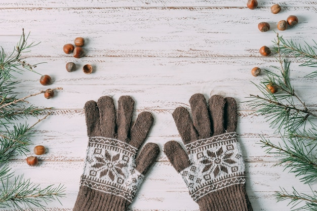 Top view decoration with gloves on wooden background Free Photo