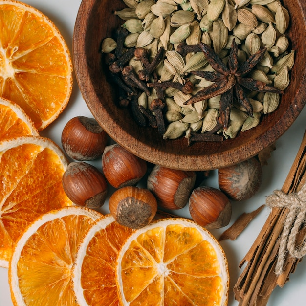 Top view decoration with orange slices and hazelnuts Free Photo