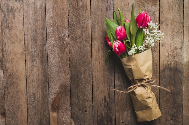 Top view of decorative bouquet on wooden table Free Photo
