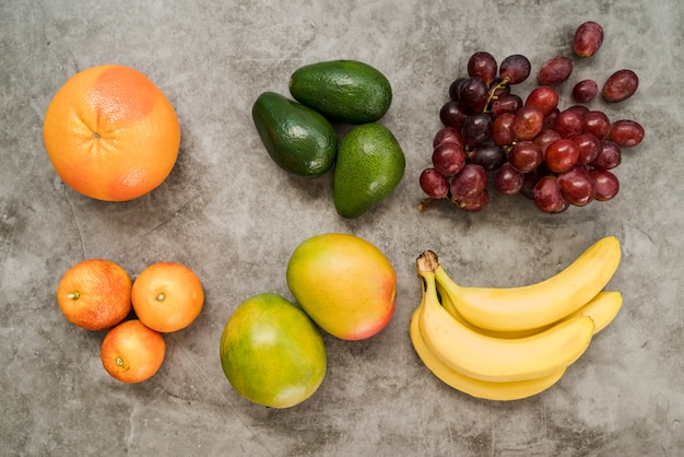 Top view delicious assortment of fruits on the table Free Photo