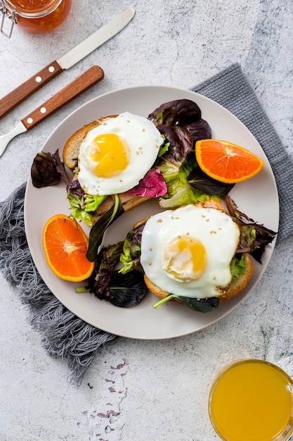 Top view delicious breakfast with lettuce and eggs Free Photo