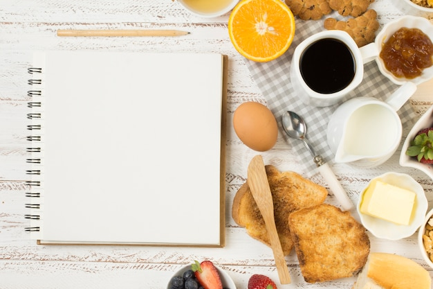 Top view delicious breakfast with notebook Free Photo