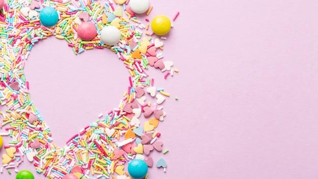 Vista dall'alto del concetto di deliziose caramelle Foto Gratuite