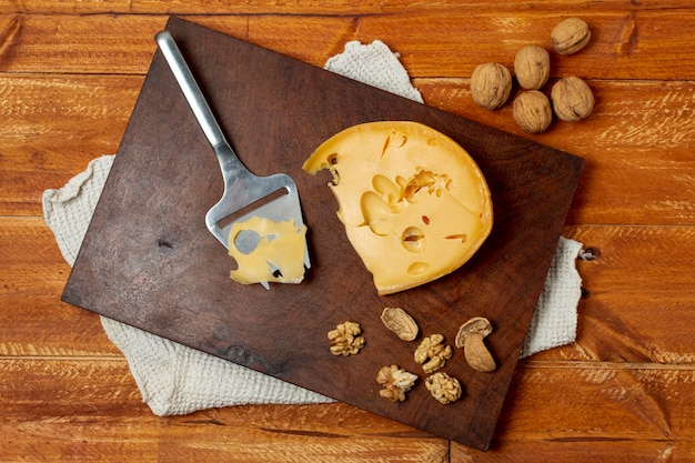 Top view delicious cheese on a wooden board Free Photo