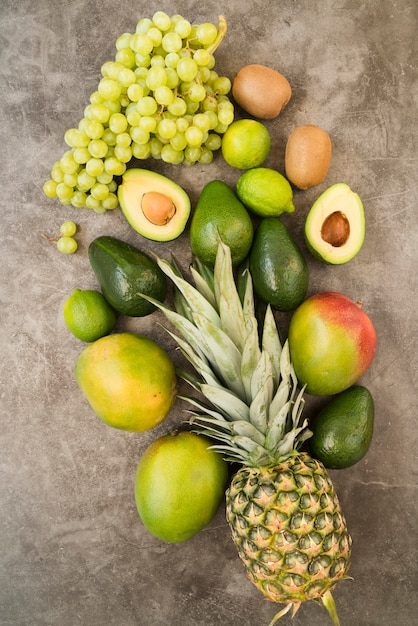 Top view delicious exotic fruits on the table Free Photo