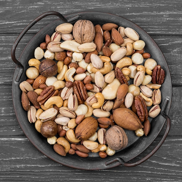 Top view delicious nuts snack on wooden table Free Photo