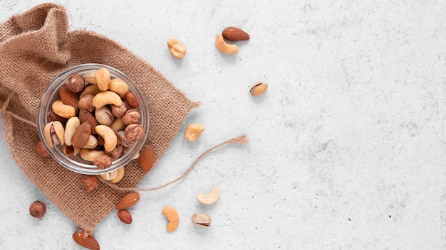 Top view of delicious nuts with copy space Free Photo