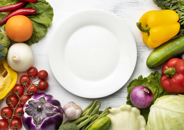 Top view delicious vegetables with plate Premium Photo