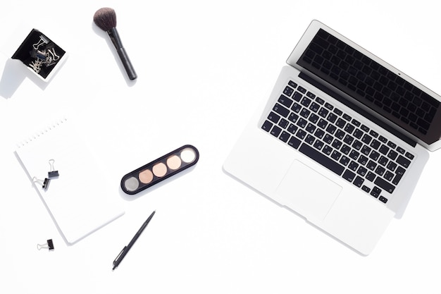 Top view desk concept with makeup Free Photo