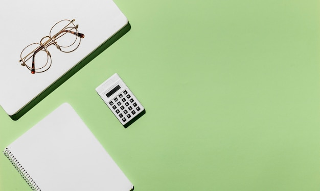 Top view desk minimal glasses and calculator Free Photo