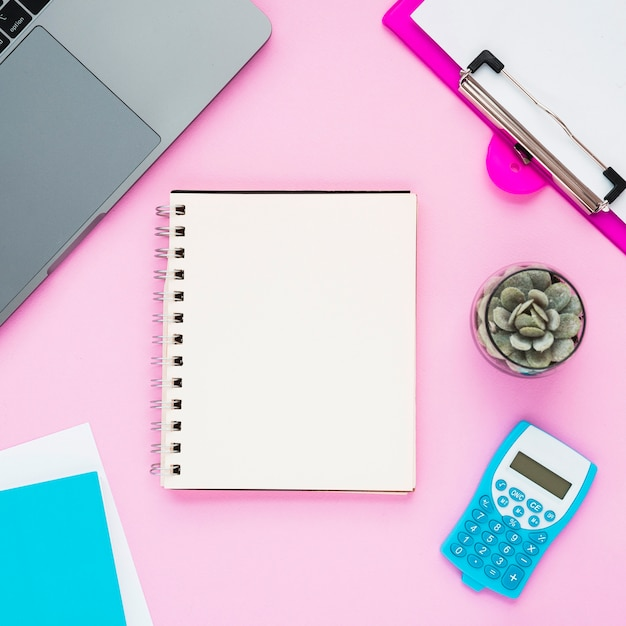 Top view of desk with blank notebook Free Photo