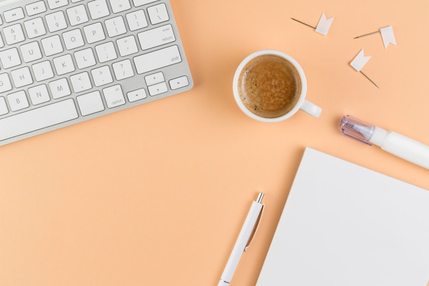 Top view of desk with keyboard and coffee Free Photo