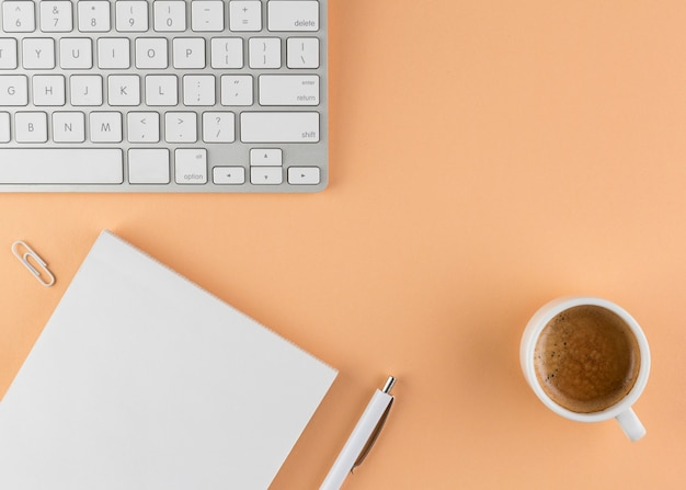 Top view of desk with paper and keyboard Free Photo