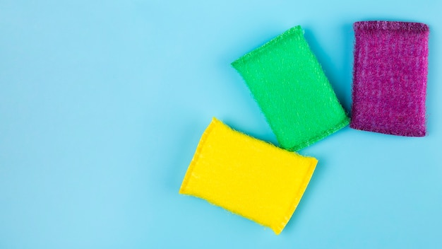 Top view different coloured sponges Free Photo