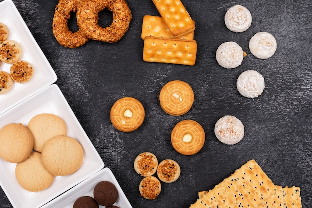Top view different cookies on dark surface Free Photo