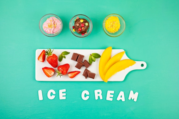 Top view of different ice cream with the ingredients Premium Photo
