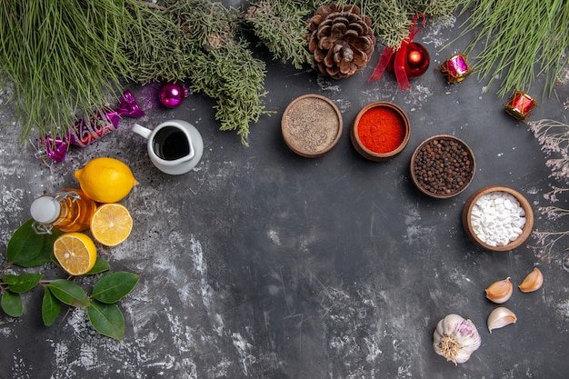 Top view different seasonings with lemon slices Free Photo