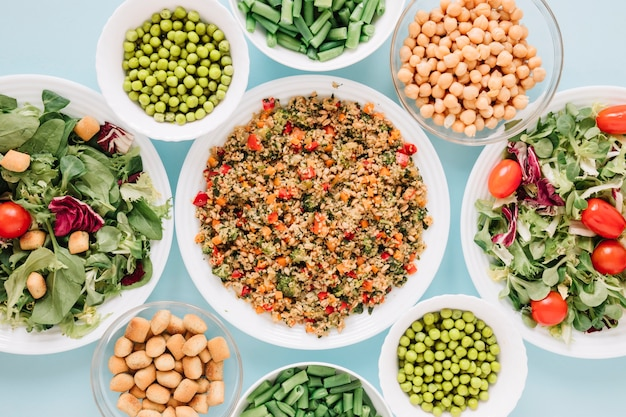 Top view of dishes with salads and chickpeas Free Photo